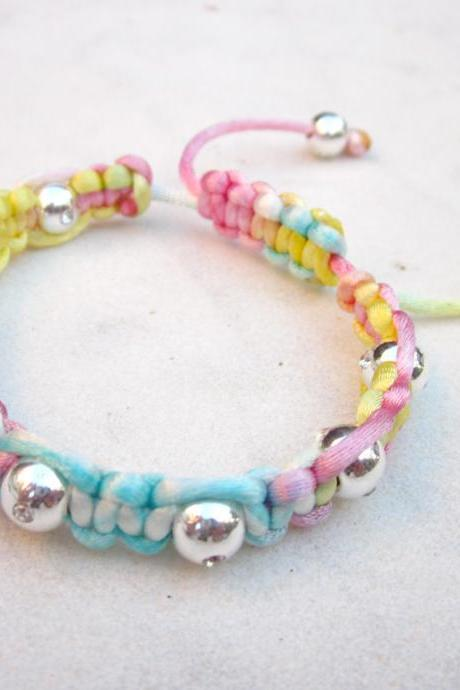 Rainbow friendship bracelet with silver beads macrame