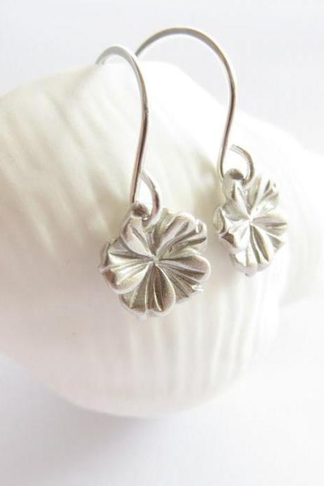 Tiny silver hibiscus earrings