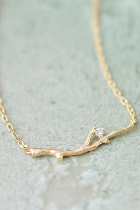 Branch with Crystal necklace in gold