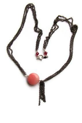 Fashion necklace. Pink and black asymmetrical necklace