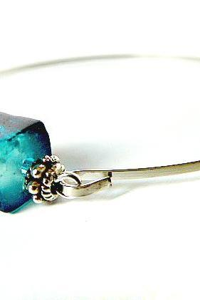 Ocean bangle bracelet by Garden of England Jewellery, silver colour wristband with a cubic glass bead combined with tibetan silver spacers