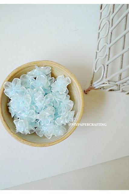Organza Light Blue color flower with pearl centered / pack