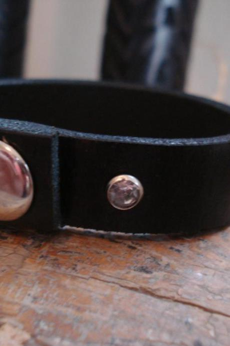 Simple black leather cuff bracelet with one rhinestone