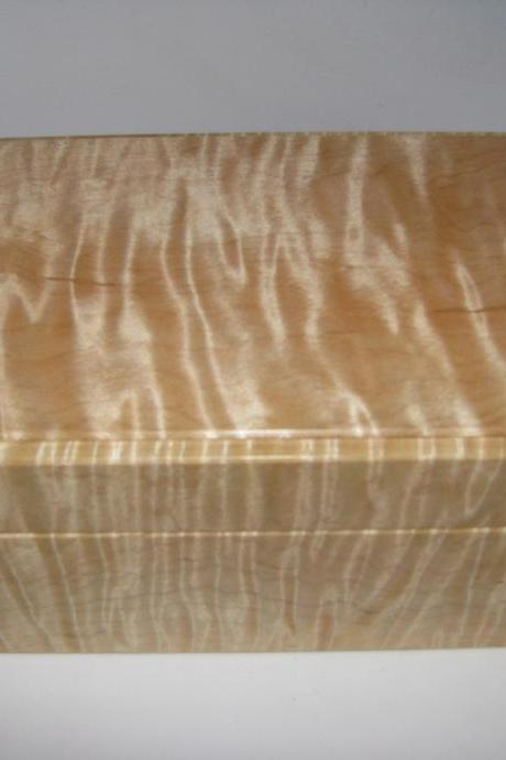 Small Tiger Maple Box Upholstered in Dark Brown Suede Fabric. 6.5' x 5' x 3'