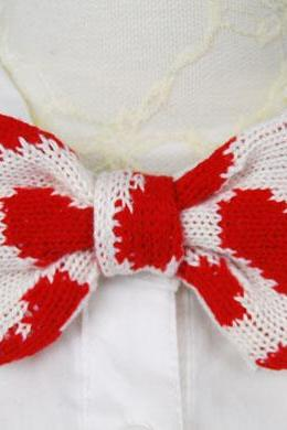 Knitted bow tie in heart pattern
