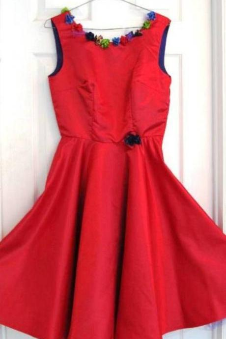 Reto style red satin dress. Hand sewn silk flowers surround the neck and back.A fun sassy dress.