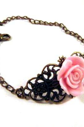 Bronzed filigree with light pink resin flower and bird charm