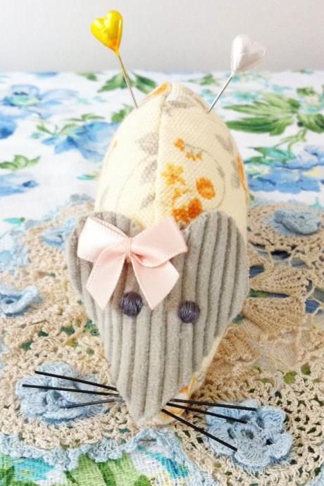 cute handmade orange floral mouse pincushion with pretty peach bow.