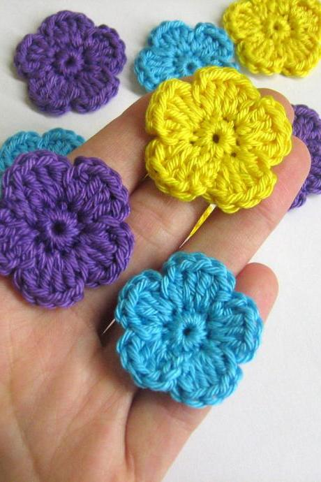 Handmade crocheted cotton flower appliques set of nine purple yellow light turquoise blue