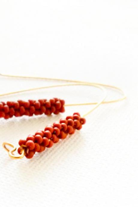 Terracotta long dangle earrings. Minimalist fashion brownish orange beaded beads jewelry. gift idea tbteam