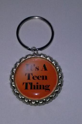 It's A Teen Thing Bottle Cap Key Chain or Zipper Pull