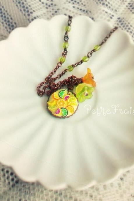 "Fruit tart necklace ""La tarte nr04"" with lucite flowers, in yellow, green and orange, polymer clay food jewelry"