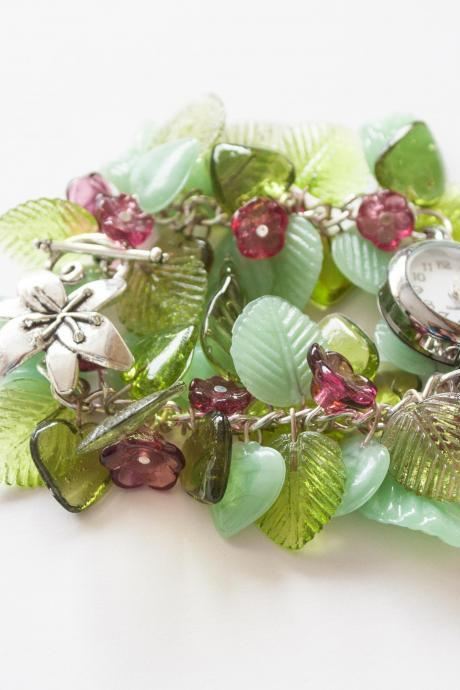 Springtime statement bracelet watch with green leaves and pink flowers,