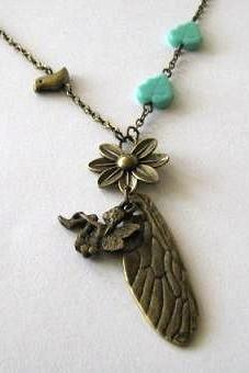 Bronzed dragonfly wing necklace jewelry with tinkerbell fairy charm, bird, flower and glass turquoise leaves