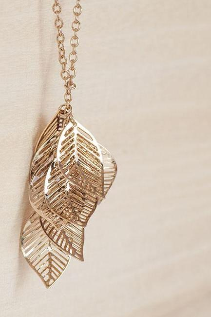 Golden Cut Out Leaf Long Statement Necklace