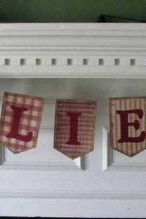 Primitive Christmas 'Believe' banner in Red Homespun print paper
