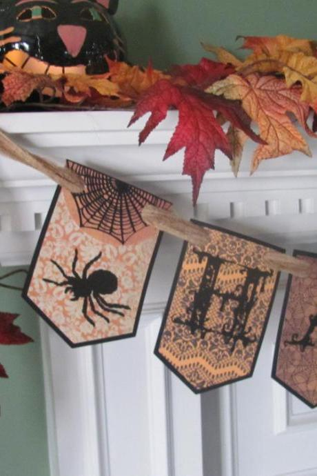 Victorian Inspired HAUNTED' Halloween Banner featuring Gothic Style Lettering with Spiders & Bats