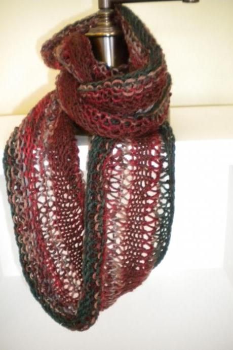 Hand knit cowl of reds and greens.