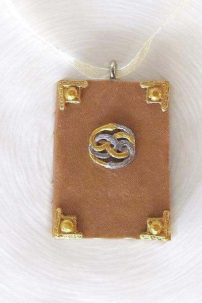 Neverending Story Book with Auryn Pendant and Ribbon Necklace