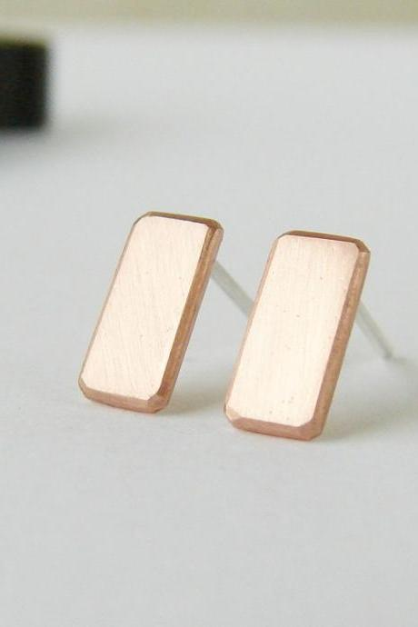Geometric earrings . Small copper studs