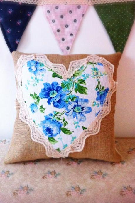 Bright blue floral heart cushion with lace detail