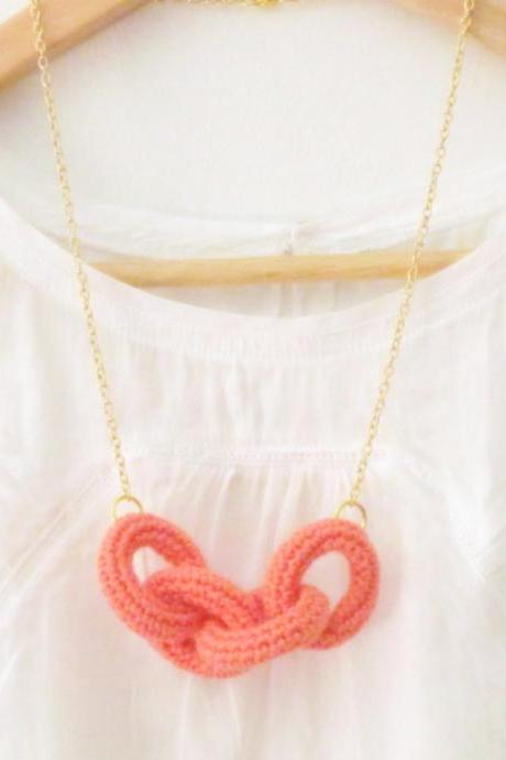 Chain reaction, crochet chain necklace. Coral pink cotton yarn