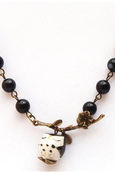 Antiqued Brass Leaf Black Agate Porcelain Owl Necklace