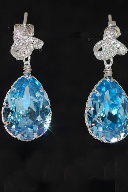Cubic Zirconia Detailed Love Knot Earring with Swarovski Aquamarine Teardrop (E487)