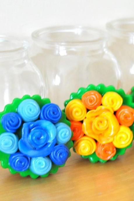 Set of three jars with polymer clay flowers