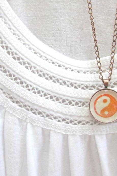 Yin yang. Round copper necklace handprinted in red