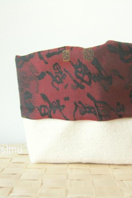 Canvas bucket with Chinese calligraphy on maroon fabric