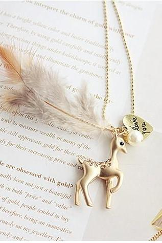 Lovely fawn diamond/sweater chain with pearl feather long necklace