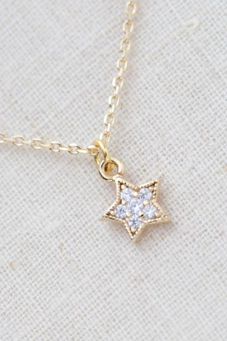 Tiny rhinestone star necklace in gold