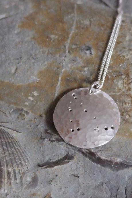 Silver Capricorn pendant: The constellation of Capricorn on a textured sterling silver pendant