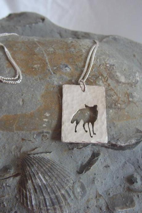 Silver Fox Pendant: A curious fox silhouette pendant on a background of textured sterling silver.