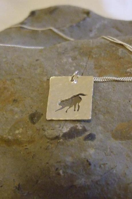 Silver Fox Pendant: A playful fox silhouette pendant on a background of textured sterling silver.