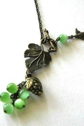 Grape necklace jewelry with green cats eye beads and bronzed sparrow