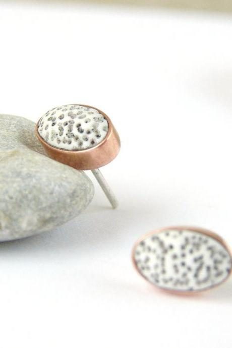 Small oval stud earrings . Porous polymer clay pebbles in copper and silver