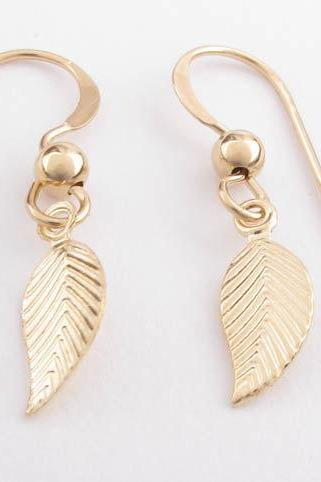 Gold leaf earrings: tiny 14k gold filled leaf drops