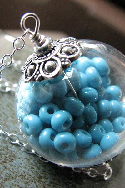 Hollow Glass Pendant Filled with Aqua Beads on a Sterling Silver Chain