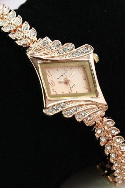 Luxury rhinestones gold colored woman watch