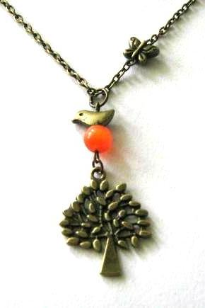 Tree and bird necklace with orange cats eye bead