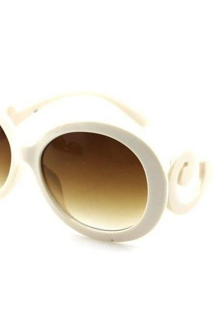 Classy woman round lens beige sunglasses