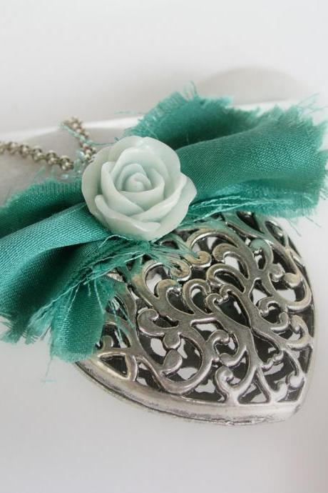 Silver heart pendant decorated with fabric and resin flower