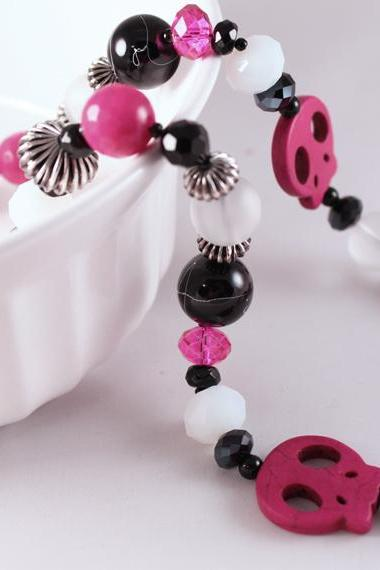 pink and black skull necklace