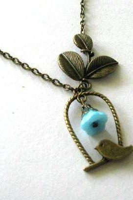 Antiqued bronze leaf and bird necklace jewelry with blue flower