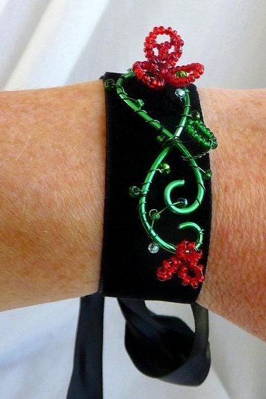 Velvet cuff with red beaded flowers
