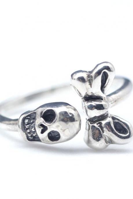 Tiny skull with ribbon ring in sterling silver
