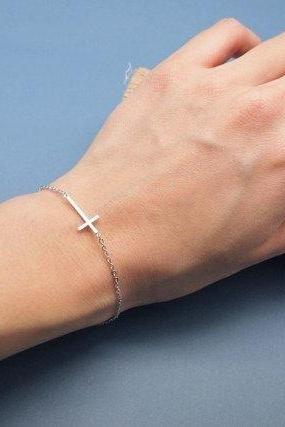 Sideways Cross pendant bracelet in silver gold
