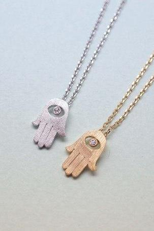 Hamsa hand pendant necklace in gold / silver